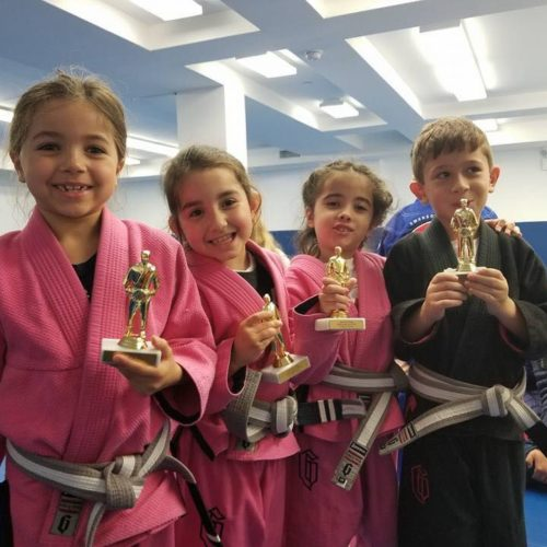 Jiu-Jitsu Students from Lifestyle MMA holding trophies