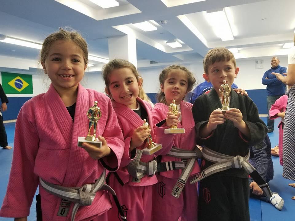 Jiu-Jitsu Students from Lifestyle MMA holding trophies