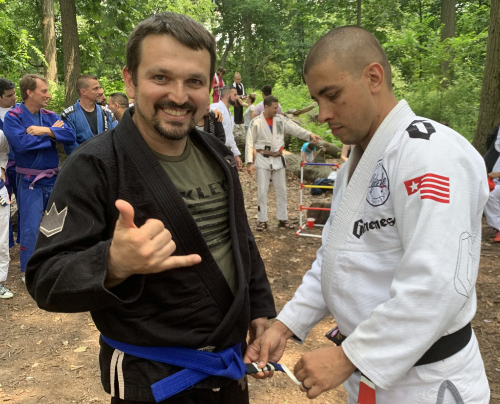 Brazilian Jiu-Jitsu Student getting stripe added to their belt at Lifestyle MMA