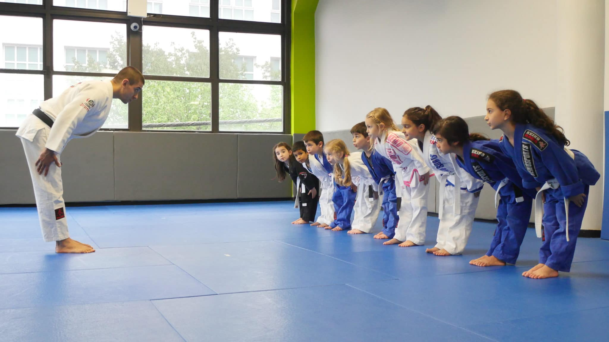 Young martial artists bowing to instructor at Lifestyle MMA